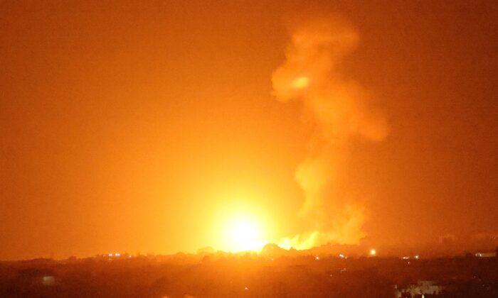 A fireball rises following an air strike in Khan Yunis in the southern Gaza Strip, late on Aug. 23, 2021. (Said Khatib/AFP via Getty Images)