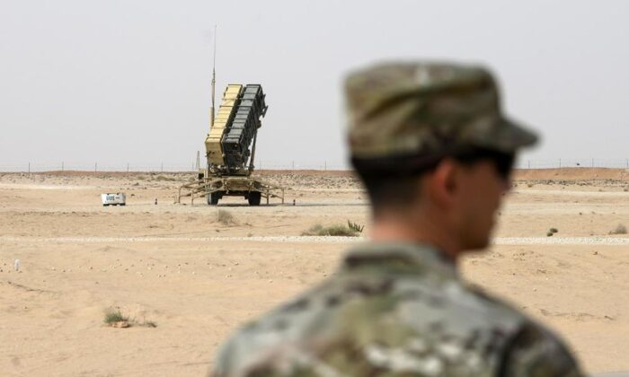 A member of the U.S. Air Force stands near a Patriot missile battery at Prince Sultan Air Base in Saudi Arabia on Feb. 20, 2020. (Andrew Caballero-Reynolds/Pool via AP, File)