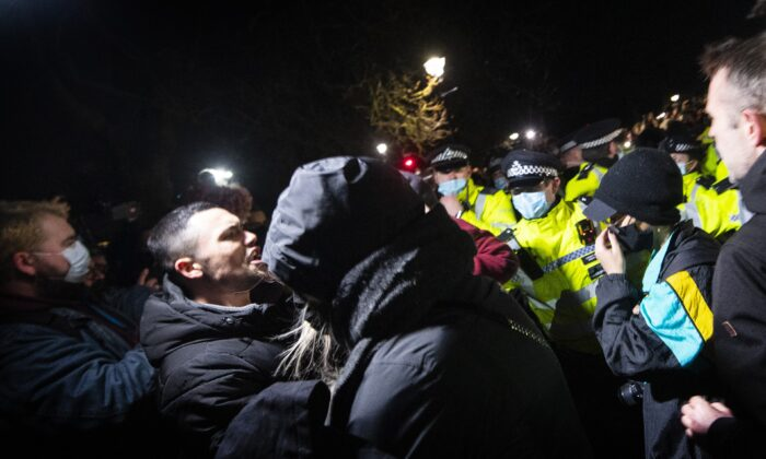 People clash with police as they gather in Clapham Common, London, after the Reclaim These Streets vigil for Sarah Everard was officially cancelled, on March 13, 2021. (Victoria Jones/PA)