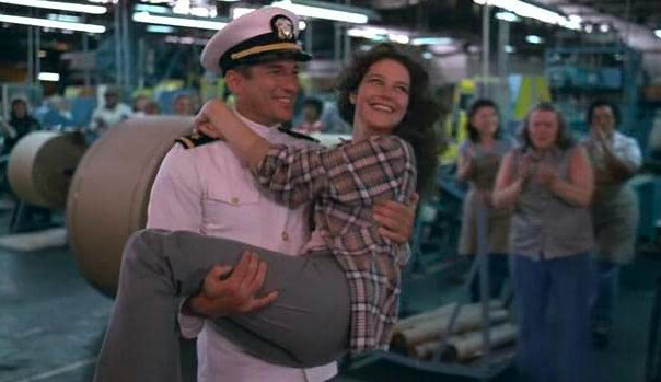 man carries woman out of factory in An Officer and a Gentleman