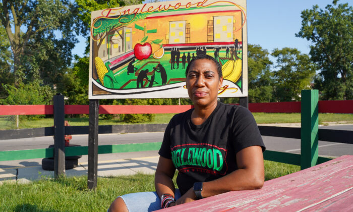 Asiaha Butler sits inside the peaceful community space she built over the years in the Englewood neighborhood on the South Side of Chicago, on Sept. 10, 2021. (Cara Ding/The Epoch Times)