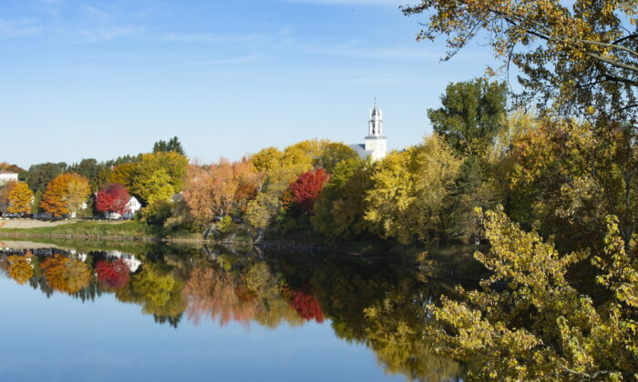 Fall colors reflecting on the Chaudière River,on October 11, 2019 in Scott Que. (The Canadian Press/Jacques Boissinot)