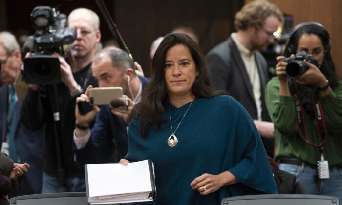 Cameras follow Jody Wilson-Raybould as she waits to testify before the House justice committee about allegations that the Prime Minister's Office pressured her to intervene in a criminal prosecution against SNC-Lavalin during her tenure as attorney general, on Feb. 27, 2019. (The Canadian Press/Adrian Wyld)
