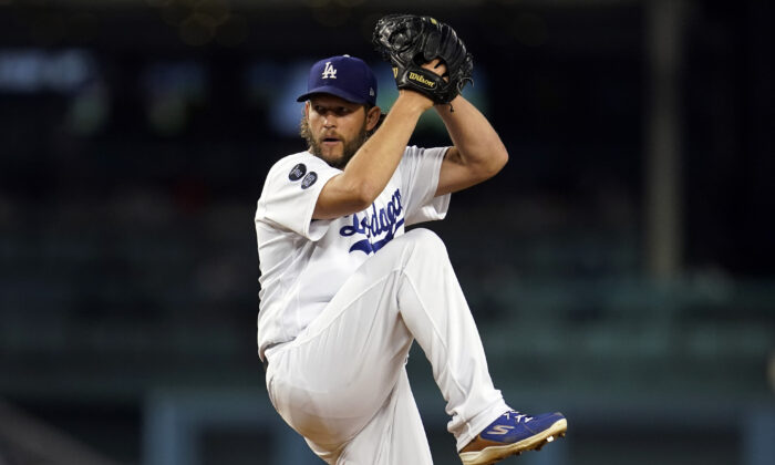 Los Angeles Dodgers starting pitcher Clayton Kershaw throws to an Arizona Diamondbacks batter during the first inning of a baseball game in Los Angeles on Sept. 13, 2021. (AP Photo/Marcio Jose Sanchez)