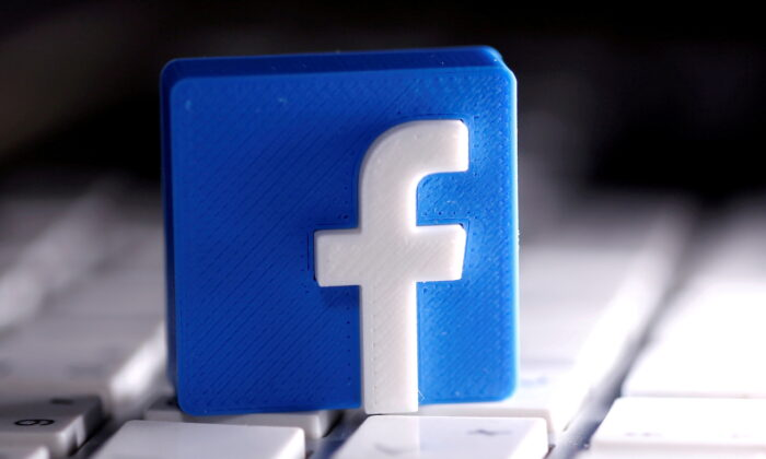 A 3D-printed Facebook logo is seen placed on a keyboard in this illustration taken on March 25, 2020. (Dado Ruvic/Illustration/Reuters)