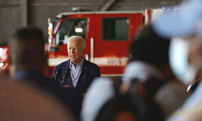 U.S. President Joe Biden delivers remarks to reporters after doing a helicopter tour with California Gov. Gavin Newsom of the Caldor fire, at Mather Airport on Sept. 13, 2021. (Justin Sullivan/Getty Images)