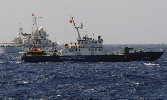 This picture taken from a Vietnam Coast Guard ship on May 14, 2014 shows a China Coast Guard ship (L) chasing a Vietnam Coast Guard vessel near the site of a Chinese oil drilling rig being installed at the disputed water in the South China Sea off Vietnam's central coast. The Vietnam National Assembly's deputies, gathered for their summer session, are discussing the escalating tensions with China over the South China Sea's contested waters.      (HOANG DINH NAM/AFP via Getty Images)