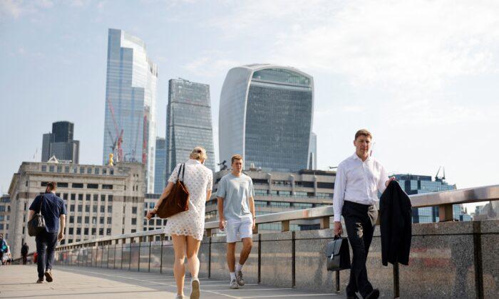 Commuters cross London Bridge on July 19, 2021. (Tolga Akmen /AFP via Getty Images)