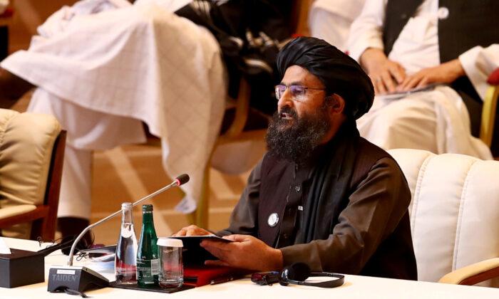 Mullah Abdul Ghani Baradar, the leader of the Taliban delegation, speaks during talks between the Afghan government and Taliban insurgents in Doha, Qatar, on Sept. 12, 2020. (Ibraheem al Omari/Reuters)