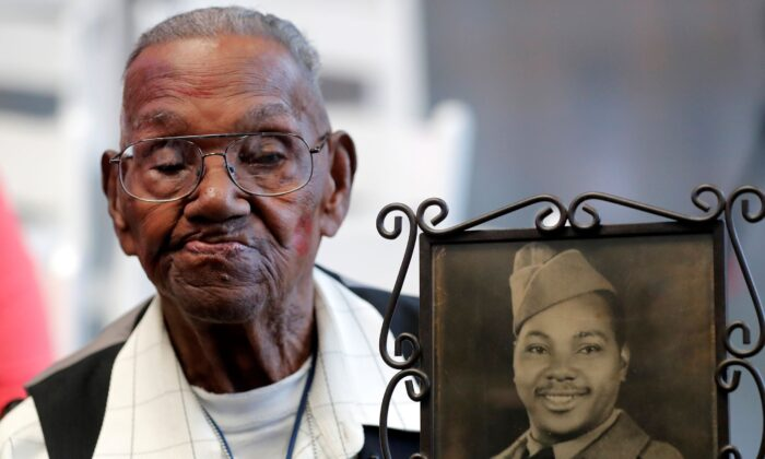 In this file photo, World War II veteran Lawrence Brooks celebrates his 110th birthday at the National World War II Museum in New Orleans, La., on Sept. 12, 2019. (Gerald Herbert/AP Photo)