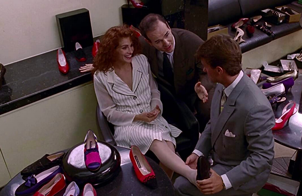 woman attended to by to salesmen in pretty woman