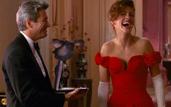 man in suit woman in red dress in pretty woman