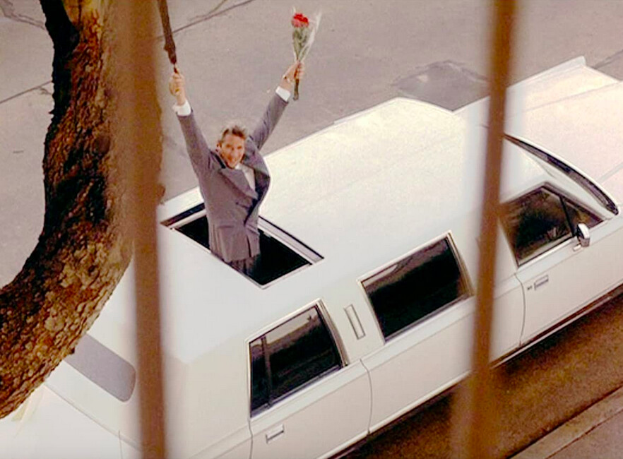 man in white limo with umbrella and flowers in pretty woman