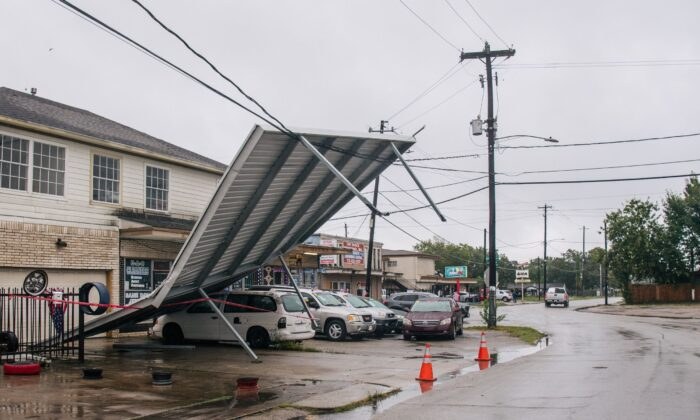 A carport hangs from power-lines after Tropical Storm Nicholas moved through the area in Houston, Texas, on Sept. 14, 2021. (Brandon Bell/Getty Images)