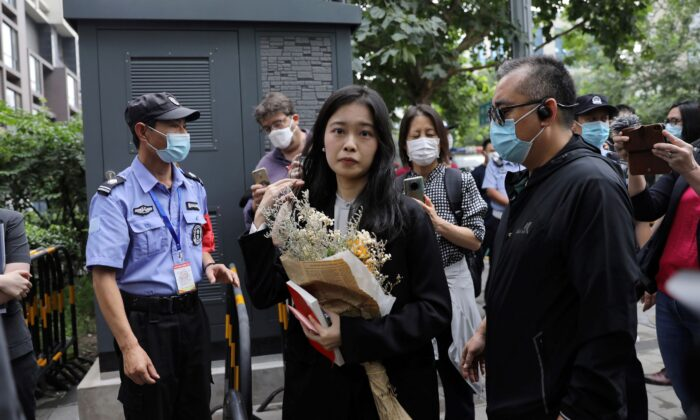 Zhou Xiaoxuan, also known by her online name Xianzi, arrives at a court for a sexual harassment case involving a Chinese state TV host, in Beijing, China, on Sept. 14, 2021. (Tingshu Wang/Reuters)