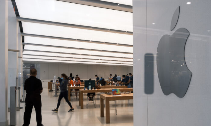 People visit the Apple store in the Oculus Mall in Manhattan in New York City on July 29, 2021. (Spencer Platt/Getty Images)
