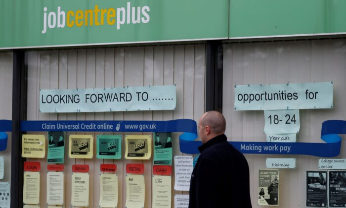 A man walks past a job centre following the outbreak of the coronavirus disease (COVID-19), in Manchester, Britain on July 8, 2020. (Phil Noble/Reuters)