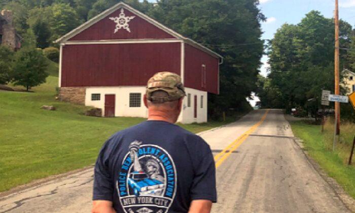 Frank Siller walks towards the site where Flight 93 went down on Sept. 11, 2001, in Shanksville, Pen. (Salena Zito)