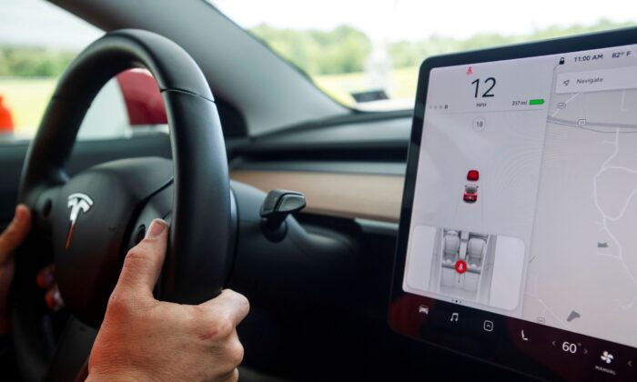 Joe Young, media relations associate for the Insurance Institute for Highway Safety (IIHS), demonstrates a front crash prevention test on a 2018 Tesla Model 3 at the IIHS-HLDI Vehicle Research Center in Ruckersville, Va., on July 22, 2019. (Amanda Voisard/Reuters)