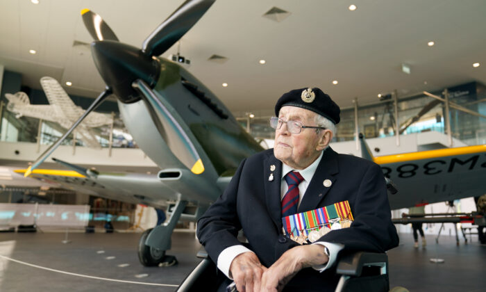 Veteran Norman Lewis, 102, beside the newly restored Spitfire at the Potteries Museum And Art Gallery in Stoke-on-Trent, Staffordshire, UK, on Sept. 13, 2021.  (Jacob King/PA)