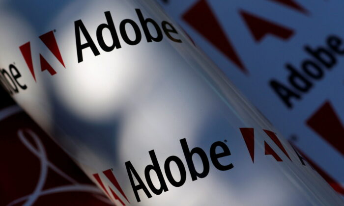 Adobe company logos are seen in this picture illustration taken in Vienna, on July 9, 2013. (Leonhard Foeger/Reuters)