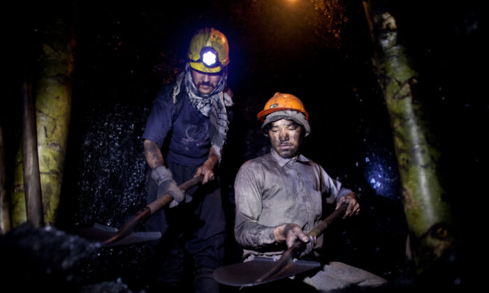 Afghan miners work in a coal mine 100 km east of the western city of Herat in Afghanistan, on June 26, 2010. (Majid Saeedi/Getty Images)
