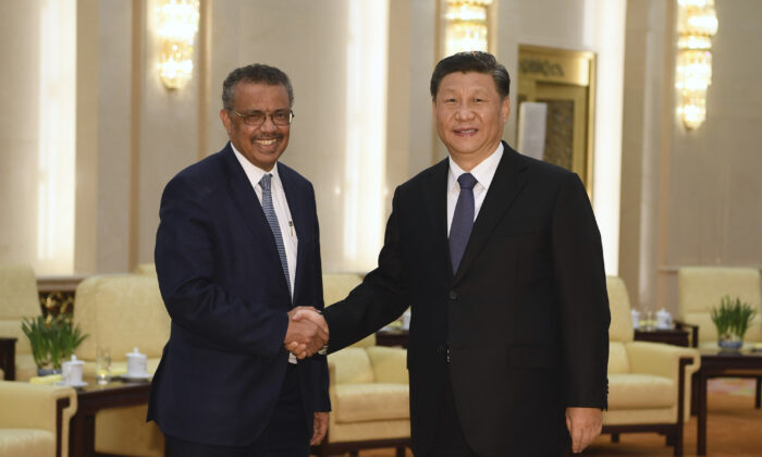 WHO Director General Tedros Adhanom (L) shakes hands with Chinese Communist Party leader Xi Jinping before a meeting in Beijing on Jan. 28, 2020. (Naohiko Hatta/Pool/Getty Images)