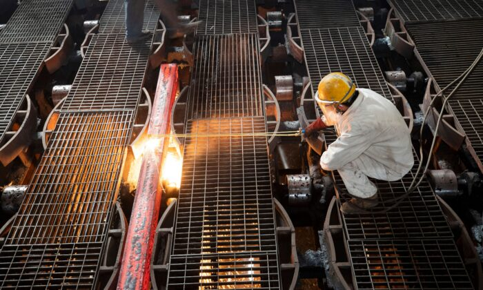 A worker makes an iron bar at a steel factory in Lianyungang, in China's eastern Jiangsu Province on Feb. 12, 2021. (AFP via Getty Images)