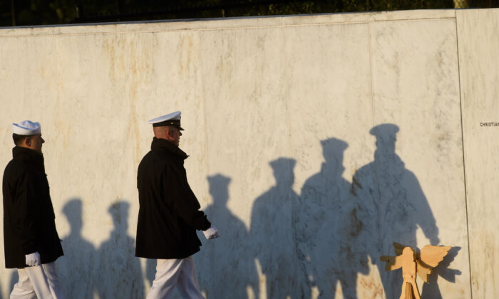 Sailors from the USS Somerset practice their formation marching at the 20th Anniversary remembrance of the 9/11 terrorist attacks at the Flight 93 National Memorial on Sept. 11, 2021, in Shanksville, Pennsylvania. (Jeff Swensen/Getty Images)