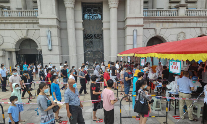 Residents queue to undergo nucleic acid tests for the COVID-19 coronavirus in Xiamen, in China's eastern Fujian Province on Sept. 14, 2021. (STR/AFP via Getty Images)