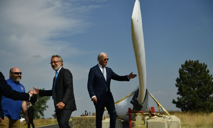 President Joe Biden looks at a wind turbine blade as he tours the National Renewable Energy Laboratory in Arvada, Colo., on Sept. 14, 2021. (Brendan Smialowski/AFP via Getty Images)