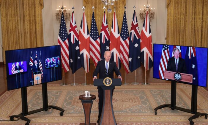 President Joe Biden speaks during an event with Australian Prime Minister Scott Morrison (L) and United Kingdom Prime Minister Boris Johnson (R) in the East Room of the White House in Washington, on Sept. 15, 2021. (Win McNamee/Getty Images)