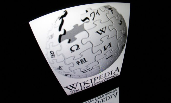"""The """"Wikipedia"""" logo is seen on a tablet screen in Paris, France on Dec. 4, 2012. (Lionel Bonaventure/AFP via Getty Images)"""