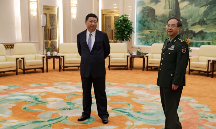 Chinese leader Xi Jinping (L) and General Fang Fenghui, chief of the general staff of the Chinese People's Liberation Army, wait to meet General Joseph Dunford, the chairman of the US joint chiefs of staff, at the Great Hall of the People in Beijing on August 17, 2017. (Andy Wong/AFP via Getty Images)