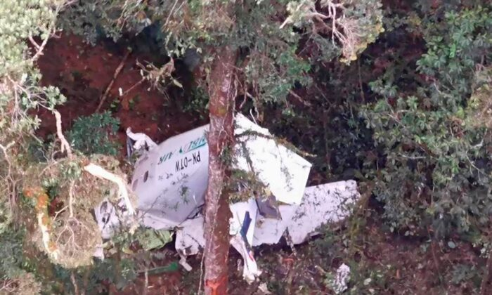 The wreckage of a small Rimbun Air cargo airplane is seen from a rescue helicopter in the mountain near Intan Jaya, Papua province, Indonesia, on Sept. 15, 2021. (Basarnas via AP)