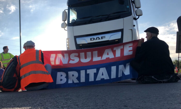 Protesters from Insulate Britain take block the M25 motorway in London, on Sept. 15, 2021. (Handout photo issued by Insulate Britain/PA)