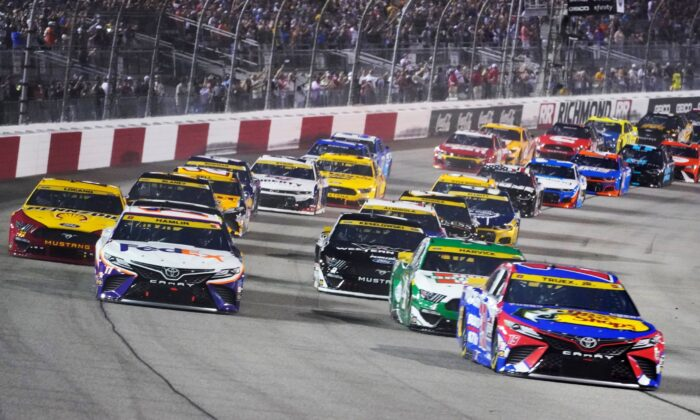 Denny Hamlin (11) and Martin Truex Jr., (19) lead the field at the start of the NASCAR Cup series auto race in Richmond, Va., on Sept. 11, 2021. (Steve Helber/AP Photo)