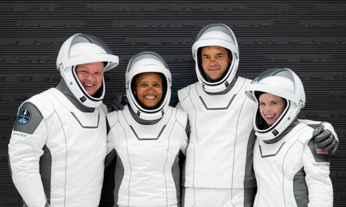The Inspiration4 crew of Chris Sembroski, Sian Proctor, Jared Isaacman, and Hayley Arceneaux poses while suited up for a launch rehearsal in Cape Canaveral, Fla., Sept. 12, 2021. (Inspiration4/John Kraus/Handout via Reuters)