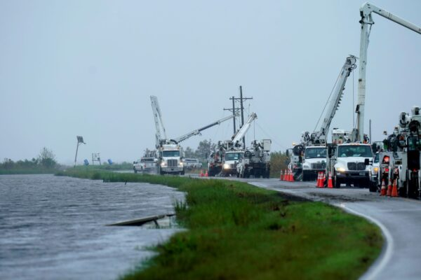 Utility crews replace power poles