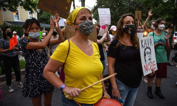 Activists protest outside the house of US Supreme Court Justice Brett Kavanaugh in  Chevy Chase Maryland, on Sept. 13, 2021. (Nicholas Kamm/AFP via Getty Images)