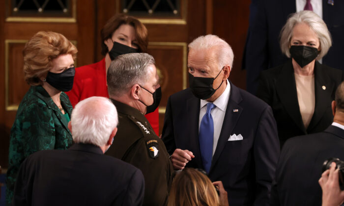 President Joe Biden speaks with Chairman of the Joint Chiefs of Staff Mark A. Milley (L) after addressing a joint session of Congress at the U.S. Capitol in Washington on April 28, 2021. (Chip Somodevilla/Getty Images)