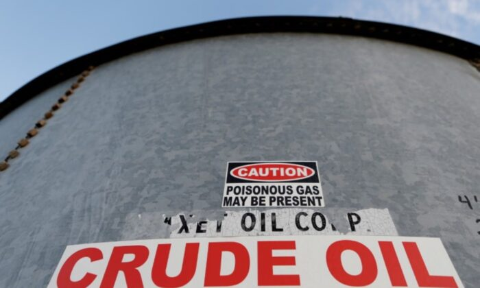 A sticker reads crude oil on the side of a storage tank in the Permian Basin in Mentone, Loving County, Texas on Nov. 22, 2019. (Angus Mordant/Reuters)