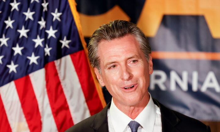 California Governor Gavin Newsom speaks after the polls close on the recall election, at the California Democratic Party headquarters in Sacramento, Calif., on Sept. 14, 2021. (Fred Greaves/Reuters)