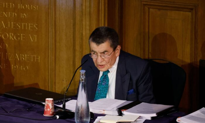 Geoffrey Nice gives the opening address on the first day of hearings at the Uyghur Tribunal, a panel of UK-based lawyers and rights experts investigating alleged abuses against Uyghurs in China, in London on June 4, 2021. (Tolga Akmen/AFP via Getty Images)