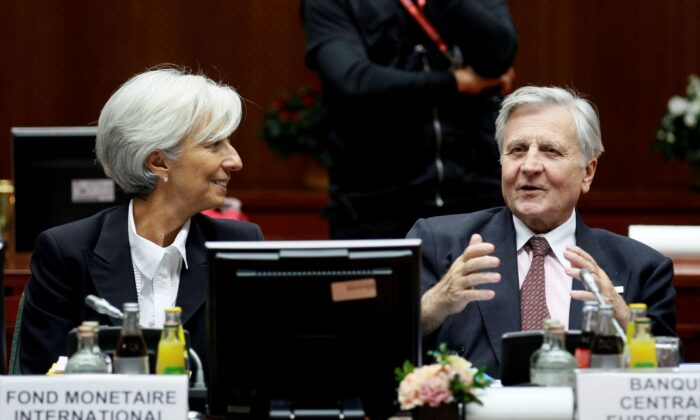 IMF President Christine Lagarde (L) and European Central Bank President Jean-Claude Trichet (R) attend a euro zone summit in Brussels on Oct. 23, 2011. (Yves Herman/Reuters)