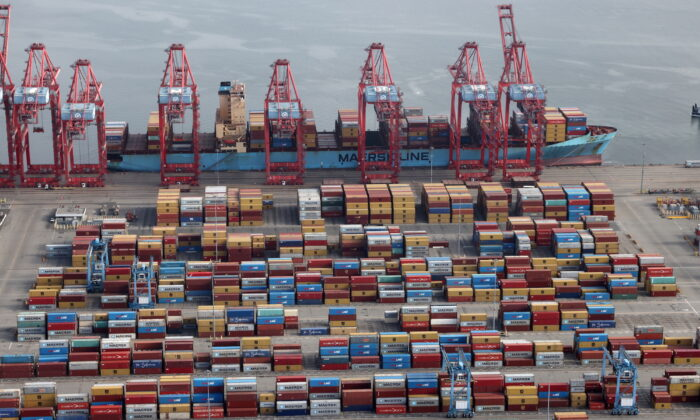 Shipping containers are unloaded from a ship at a container terminal at the Port of Long Beach-Port of Los Angeles complex on April 7, 2021. (Lucy Nicholson/File Photo/Reuters)