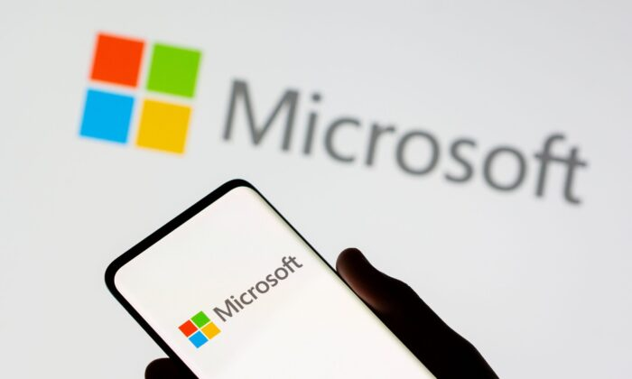 A smartphone is seen in front of a Microsoft logo displayed in this illustration taken on July 26, 2021. (Dado Ruvic/Illustration/Reuters)