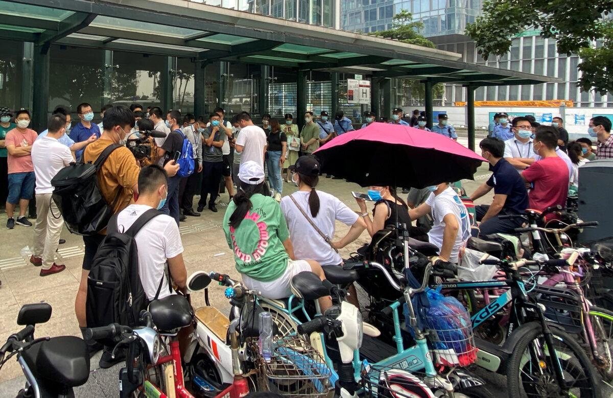people-gather-outside-evergrande