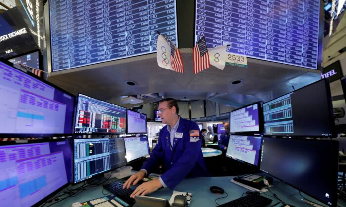 A trader works at the New York Stock Exchange (NYSE) in Manhattan, New York City on Aug. 19, 2021. (Andrew Kelly/Reuters)