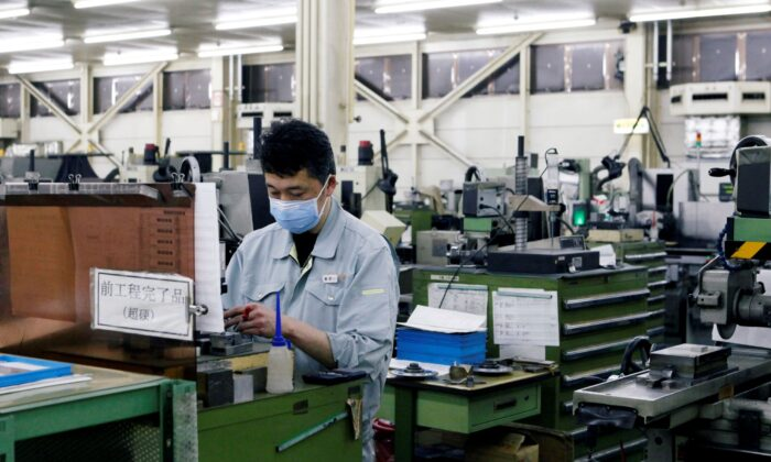A worker is seen at the factory of Nagumo Seisakusho Co., Ltd. in Jyoetsu, Niigata prefecture, Japan   on Feb. 22, 2019. (Tetsushi Kajimoto/Reuters)